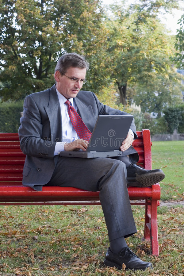 Download Businessman with laptop stock image. Image of mobile, bench - 3340235