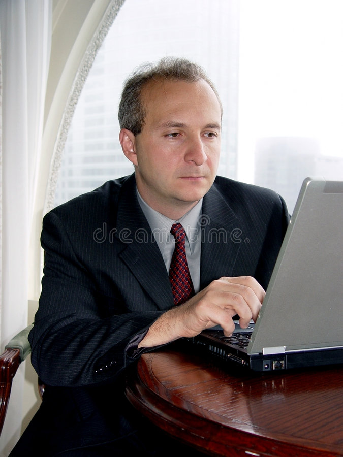 Businessman with laptop royalty free stock images