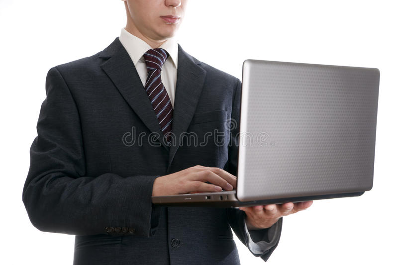 Businessman with laptop royalty free stock photography