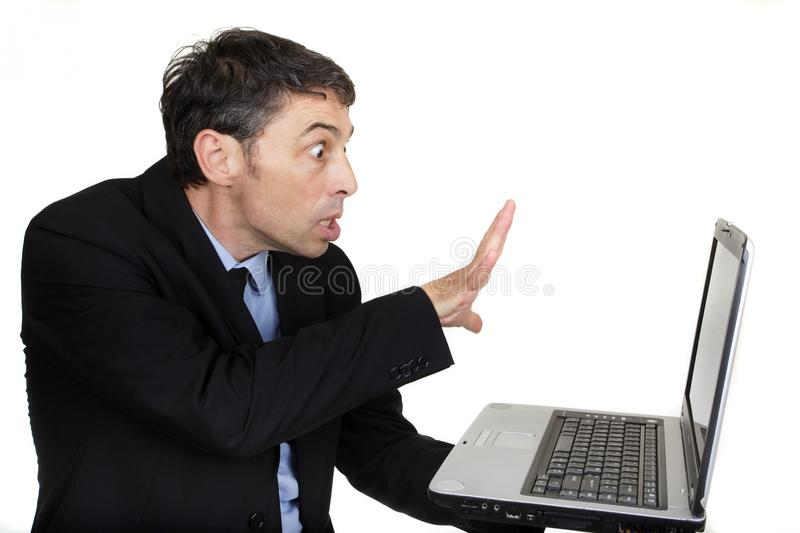 Businessman and laptop stock photography