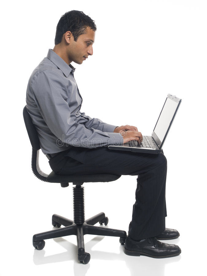Businessman - laptop chair royalty free stock image