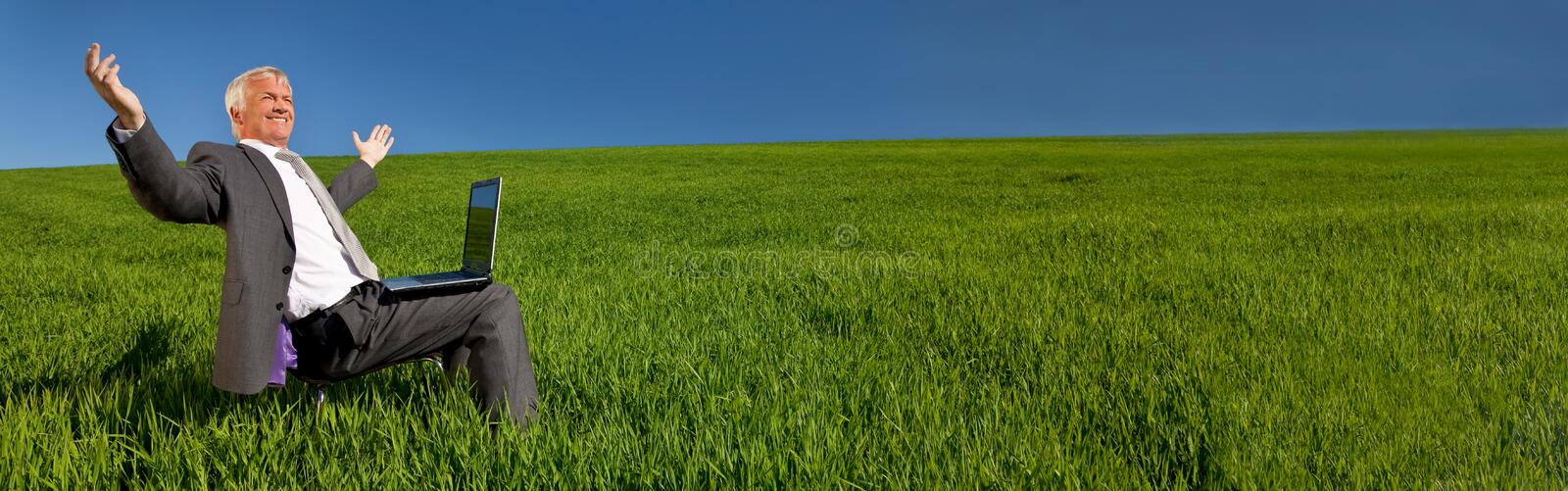 Businessman With Laptop Computer in Green Field Banner Panorama stock image