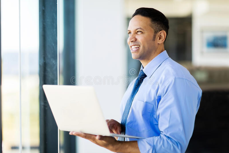 Businessman laptop computer. Modern businessman with laptop computer stock images