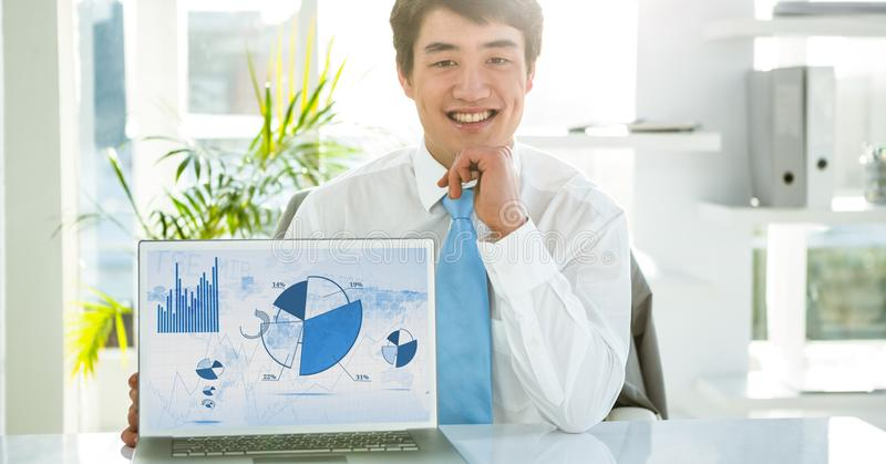 Businessman with laptop displaying graph charts on screen royalty free stock photos