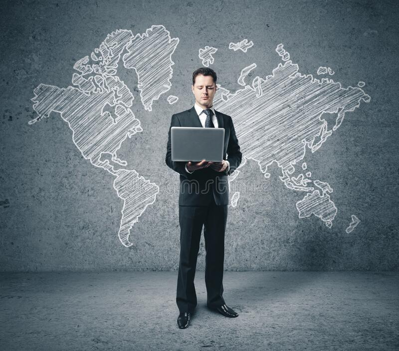 Businessman with laptop and drawing world map stock photos
