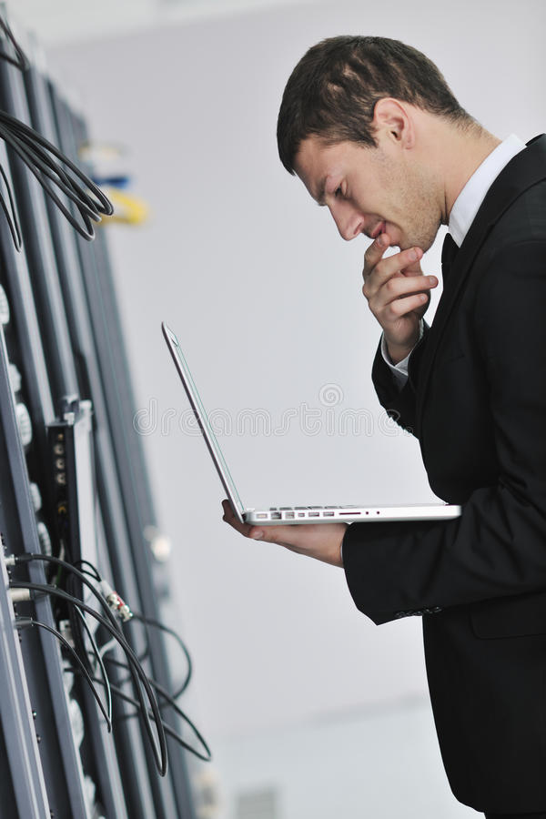Download Businessman With Laptop In Network Server Room Stock Image - Image: 17450435