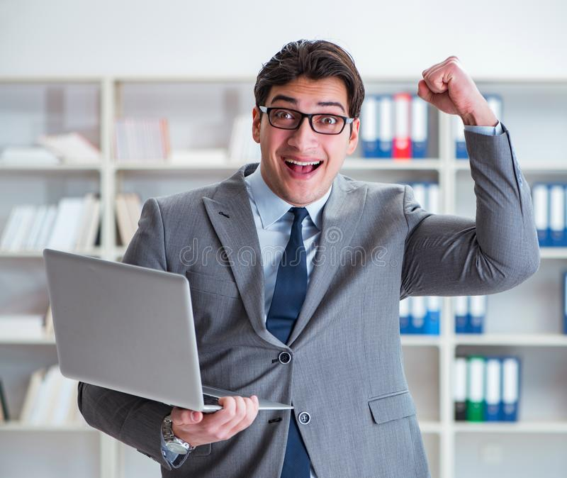 Businessman with laptop in the office royalty free stock photo