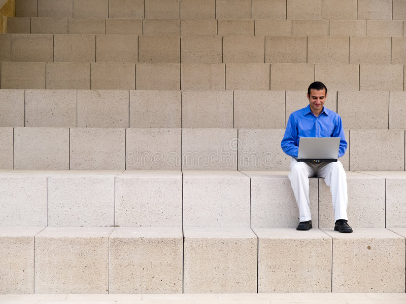 Businessman laptop and steps stock photography
