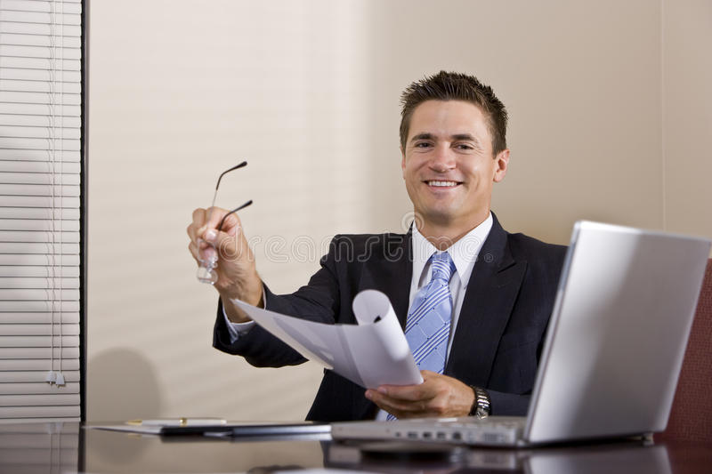 Businessman With Laptop Working In Boardroom Stock Images