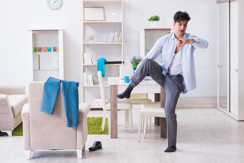 Businessman late for office due to oversleeping after overnight royalty free stock photography