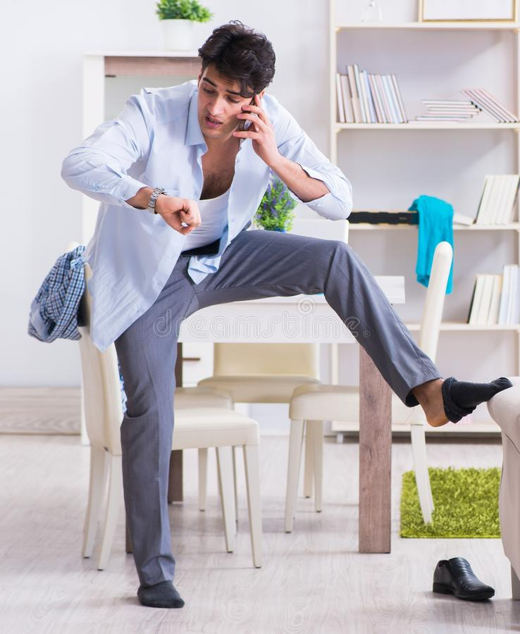Businessman late for office due to oversleeping after overnight. Working stock photo