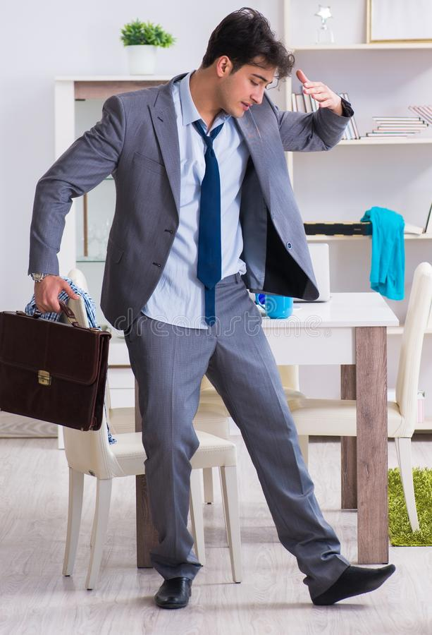 Businessman late for office due to oversleeping after overnight. Working stock photos