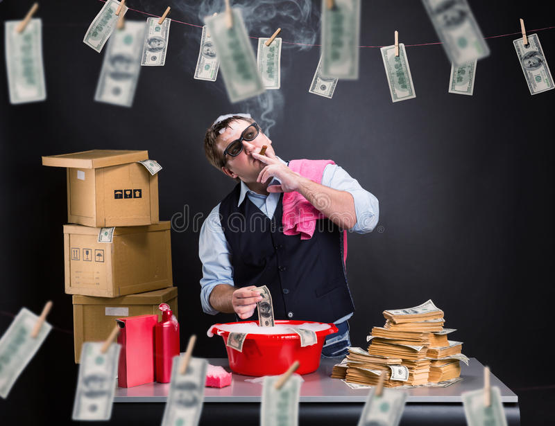 Businessman is laundering money in the basement. Smoking businessman is laundering money in the basement stock images
