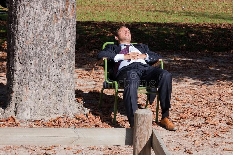 Businessman in lawn chair stock photos