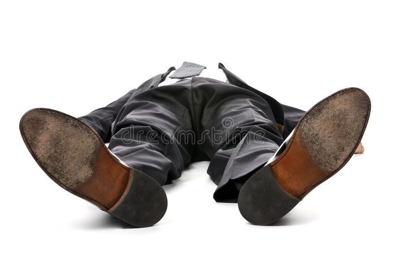 Businessman laying down on white background stock image