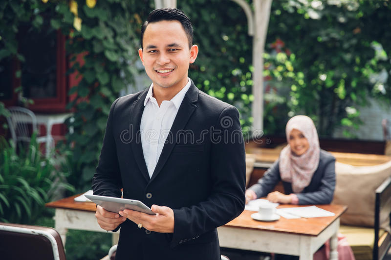 Businessman leader standing in front of his team stock photo