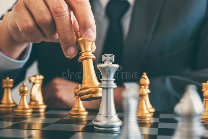 Businessman leadership playing chess and thinking strategy plan royalty free stock photo