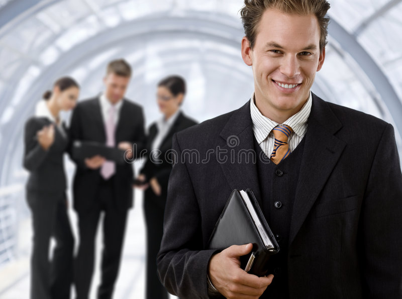 Businessman leading business team stock image