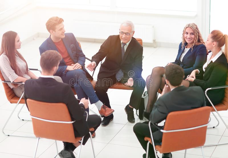 Businessman Leading Meeting At Boardroom royalty free stock photography
