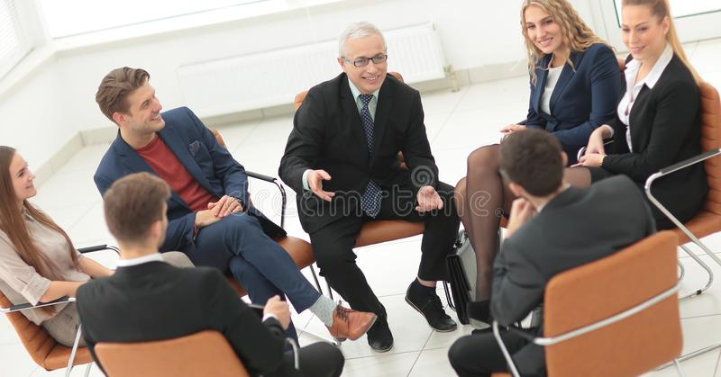 Businessman Leading Meeting At Boardroom royalty free stock photo