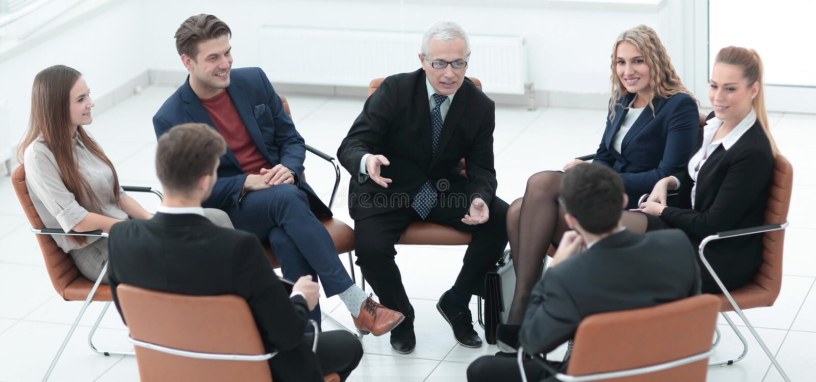 Businessman Leading Meeting At Boardroom stock photo