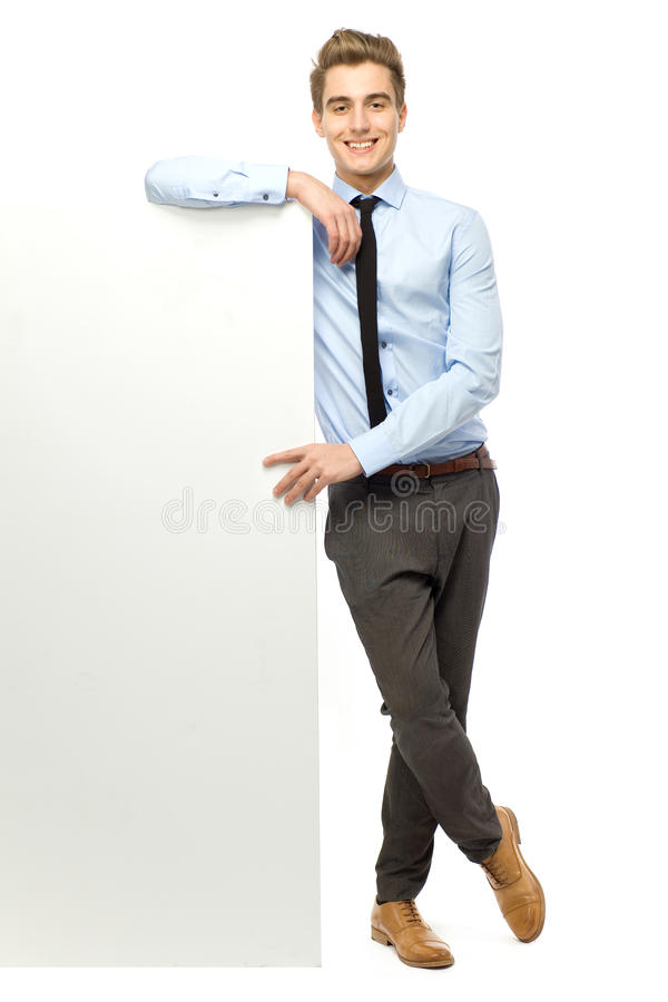 Download Businessman Leaning Against Blank Billboard Stock Photo - Image: 23715026