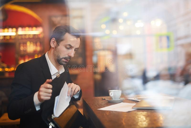 Businessman leaving Cafe stock image