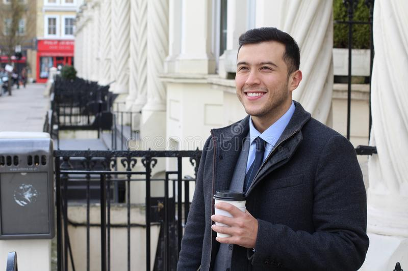 Businessman leaving his household in the morning stock photography