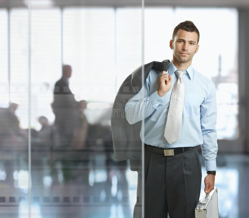 Businessman leaving office royalty free stock photo