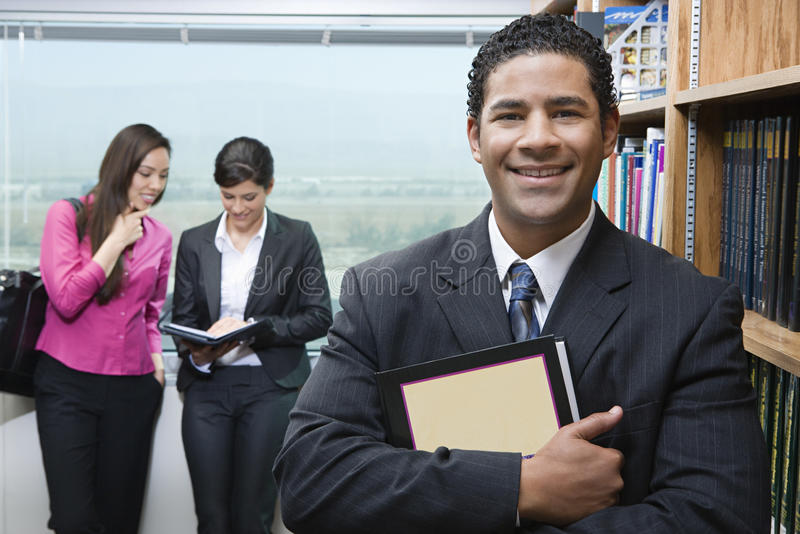 Businessman In Library stock photography