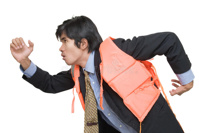 Businessman in life jacket escaping. Young Asian executive or corporate businessman in suit, necktie and life vest running and rushing to escape imminent royalty free stock images