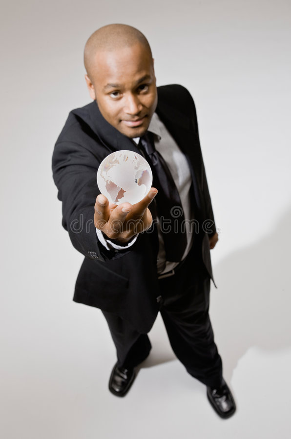 Businessman Lifting Glass Globe Paperweight Royalty Free Stock Photo
