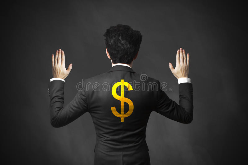 Businessman lifting hands up arrested dollar. Manager lifts hands up getting arrested golden dollar symbol royalty free stock photo