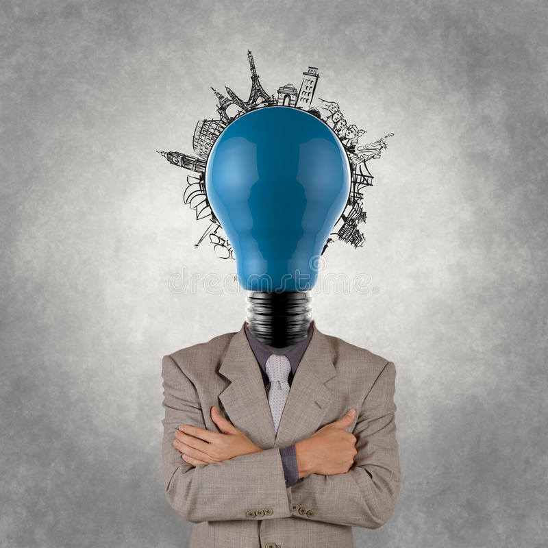 Businessman and light bulb head and traveling around the world stock image
