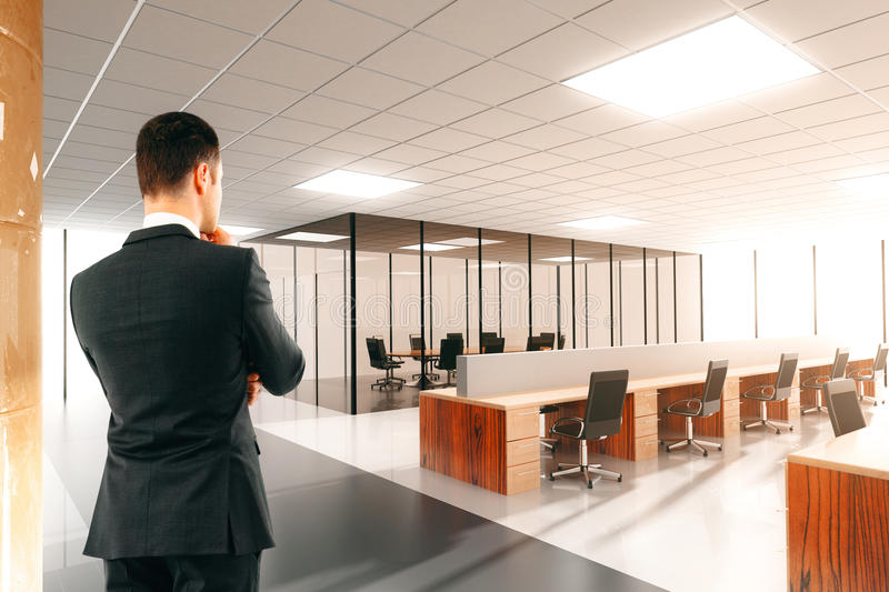 Businessman in the light open space office stock image