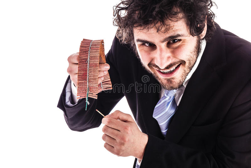 Businessman lighting firecrackers stock image