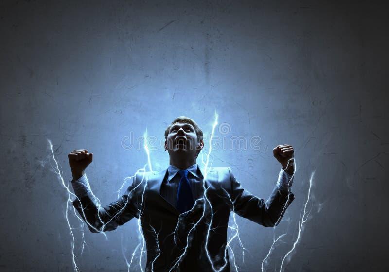 Businessman with lightning stock photos