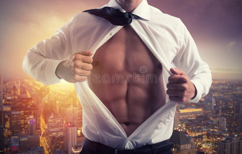 Businessman like a super hero. Concept of determination and success stock image