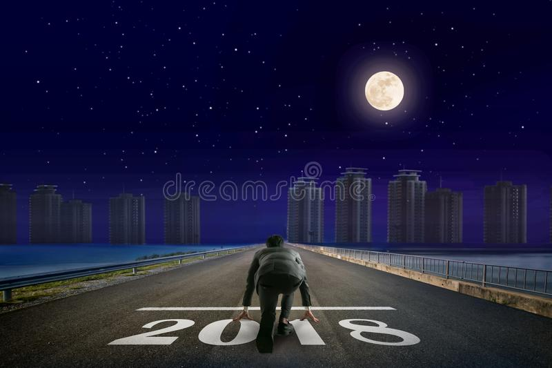 Businessman 2018 line in front of city. Night back view. Element stock images