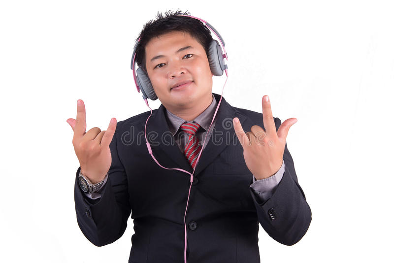 Businessman listening to music, business singing with loud musi royalty free stock image
