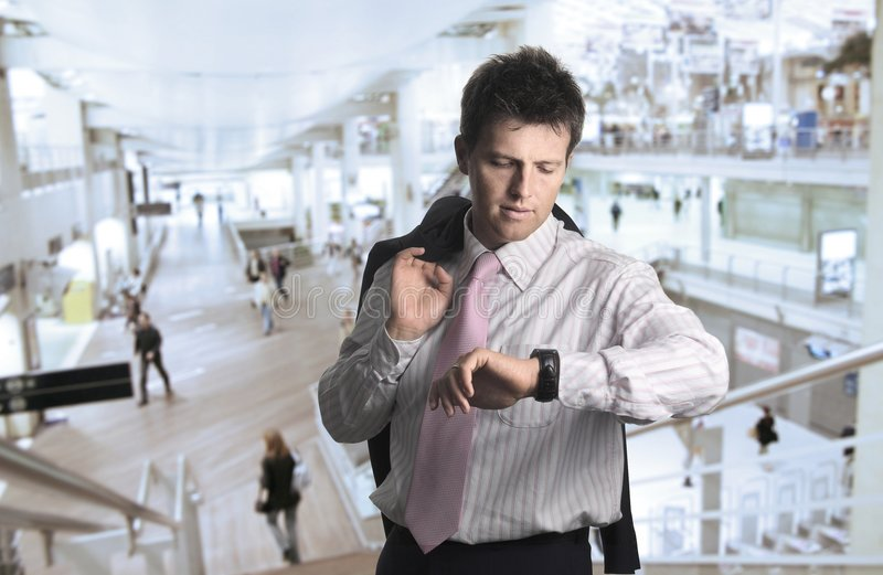 Businessman in the lobby royalty free stock image