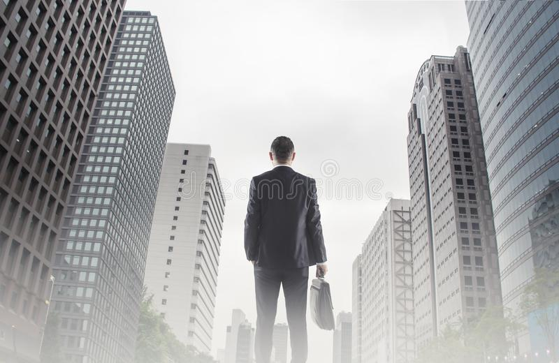 Businessman looking across the city financial district concept for entrepreneur, leadership and success royalty free stock images