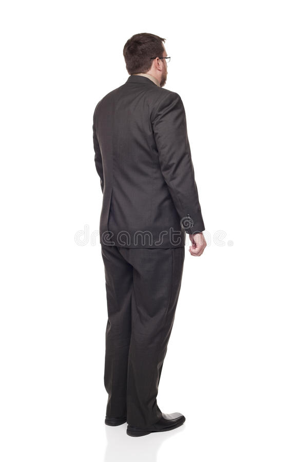 Businessman looking away full length. Isolated full length studio shot of the rear view of a businessman in full suit looking away from the camera stock photography