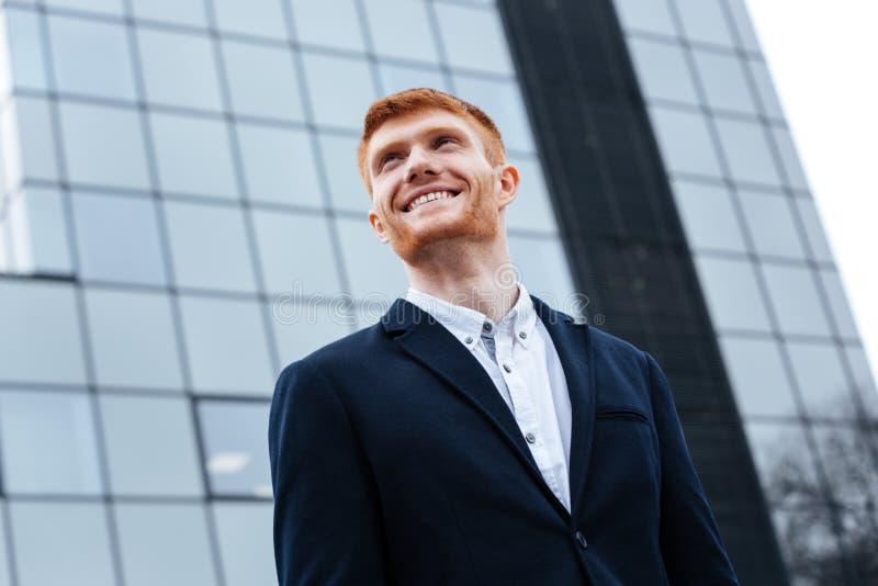 Businessman looking away outdoors stock photo