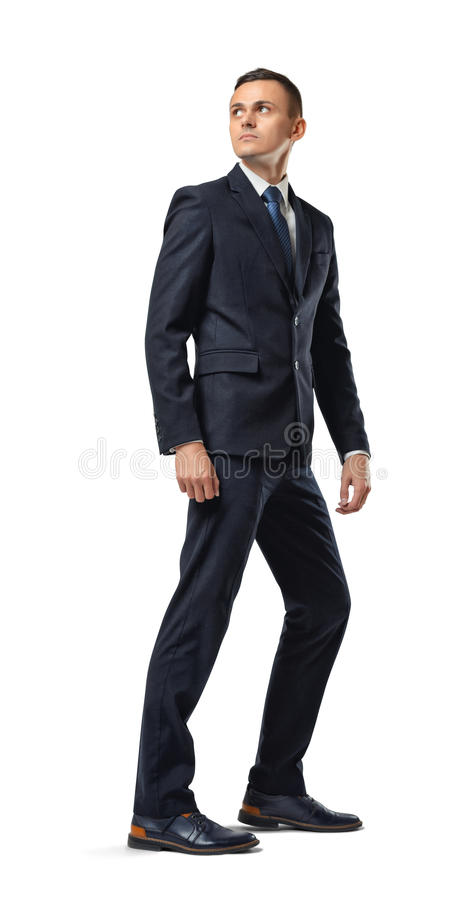 Businessman looking backwards isolated on a white background stock photography