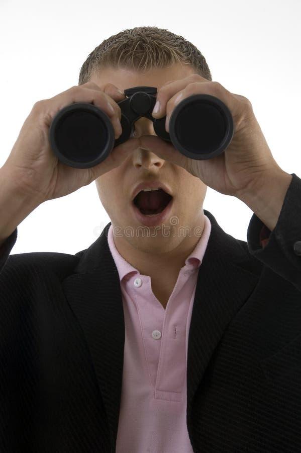 Businessman looking into binocular royalty free stock image