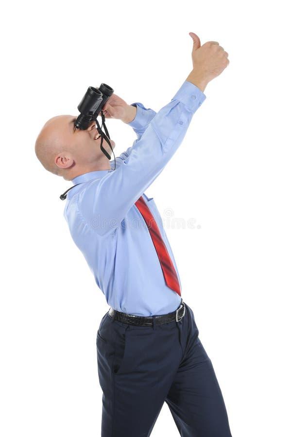 Businessman Looking Through Binoculars Royalty Free Stock Photography