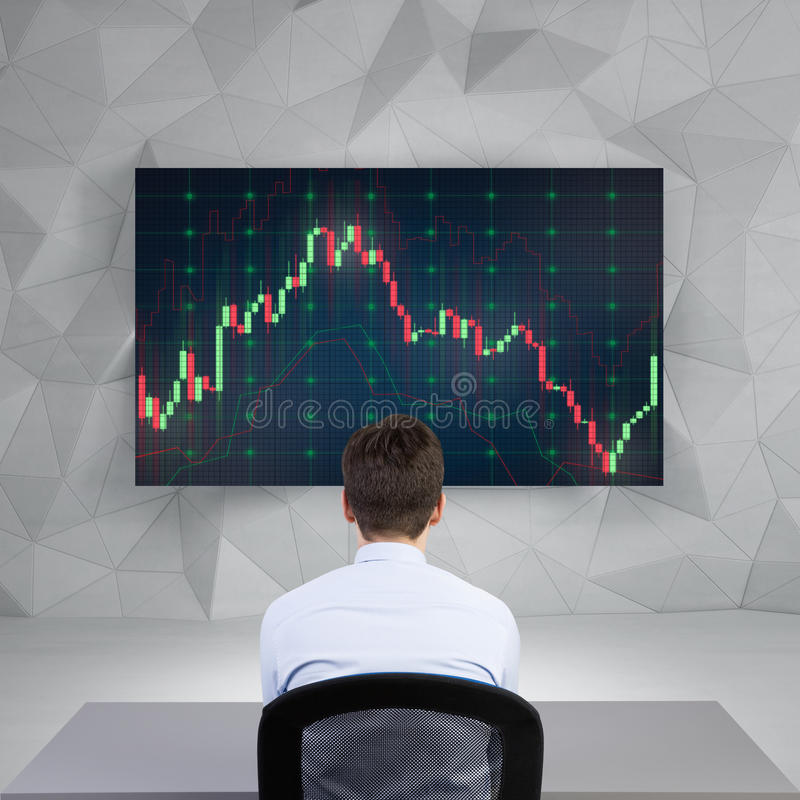 Businessman looking on chart. Businessman looking on stock chart on screen royalty free stock photo