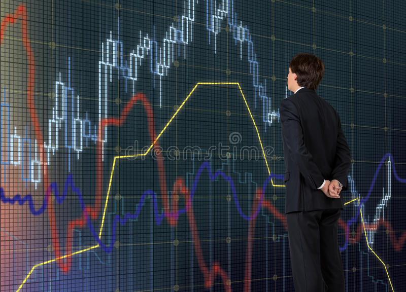 Businessman looking on chart. Businessman looking on stock chart on virtual screen royalty free stock photos