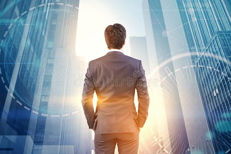 Businessman looking at city, hud and network stock photos